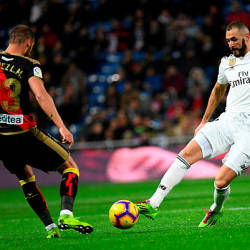 Real Madrid's French forward Karim Benzema (R) vies with Rayo Vallecano's Spanish defender Sergio Akieme during the Spanish League football match between Real Madrid and Rayo Vallecano at the Santiago Bernabeu stadium in Madrid on Dec 15, 2018. — AFP