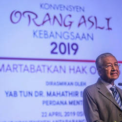 Prime Minister Tun Dr Mahathir Mohamad gives a speech at the opening of the National Orang Asli Convention 2019 at the Putrajaya International Convention Centre on the April 22, 2019. — Sunpix by Amirul Syafiq Mohd Din