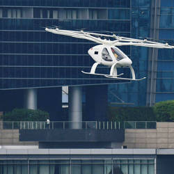 A Volocopter unmanned air taxi transport flies over Marina Bay during test flight with a safety pilot at the 26th Intelligent Transport Systems World Congress (ITSWC) in Singapore on October 22, 2019. — AFP