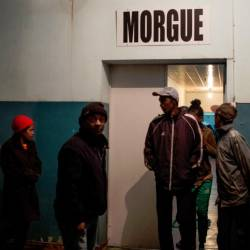 People walk out of the morgue at Joseph Ravoahangy Andrianavalona Hospital (HJRA) in Antananarivo late on June 26, 2019, after at least 16 people died and dozens were injured during independence day celebrations. — AFP