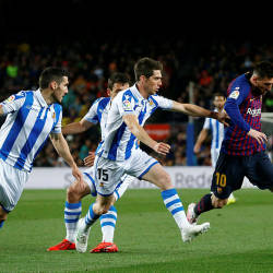 Barcelona's Lionel Messi (R) vies with Real Sociedad's Spanish Aritz Elustondo (2R) during their La Liga match at the Camp Nou, on April 20, 2019. — AFP