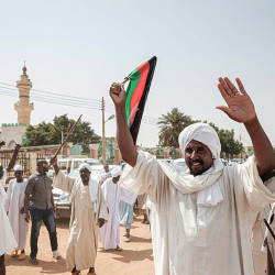 People react as they leave a mosque where Sudanese top opposition leader and former premier attended Friday prayers in the capital Khartoum's twin city Omdurman on June 14, 2019. Sudan's veteran opposition leader Sadiq al-Mahdi called today for an 'objective' international investigation into last week's deadly crackdown on protesters, after the ruling military council rejected such a probe. — AFP