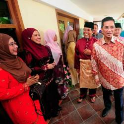 Minister of Economic Affairs Datuk Seri Mohamed Azmin Ali (C) is accompanied by Datuk Mohd Amin Ahmad Ahya when attending an open house in conjunction with the Hari Raya Aidilfitri celebration at Seri Indera, Section 7 Shah Alam on June 14, 2019. - Bernama