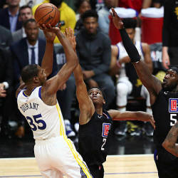 Kevin Durant of the Golden State Warriors shoots the ball against Shai Gilgeous-Alexander and Montrezl Harrell of the Los Angeles Clippers during the first half at Staples Center on April 18, 2019 in Los Angeles, California. — AFP