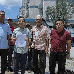 PKR communications director Fahmi Fadzil with the police report against Datuk Abibullah Samsudin, on May 18, 2019. — Bernama