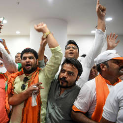 Indian Bharatiya Janata Party (BJP) supporters shout slogans as they celebrate on the vote results day for India's general election in New Delhi on May 23, 2019. — AFP