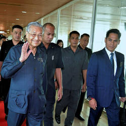 Prime Minister Tun Dr Mahathir Mohamad waves to the media, following arrival at the Kota Kinabalu International Airport, on Sept 17, 2019. — Bernama