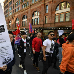 Pro-China activists march on the streets of Sydney on Aug 17, 2019, as they rally against ongoing protests in Hong Kong. — Bernama