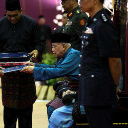 Housing and Local Government Minister Zuraida Kamaruddin (L) presents to Penang's Yang di-Pertua Negri Tun Dr Abdul Rahman Abbas, the letter of declaration for Seberang Prai as a city, on Sept 16, 2019. — Bernama