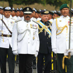 Sultan of Johor, Sultan Ibrahim Almarhum Sultan Iskandar (in black) greets the parade of honour while attending his official birthday ceremony at the Dewan Singgahsana Istana Besar on March 23, 2019. — Bernama