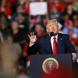 President Donald Trump speaks to supporters at a rally in Manchester on Aug 15, 2019 in Manchester, New Hampshire. — AFP