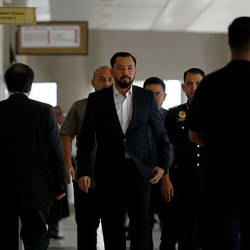 Filepix taken on Sept 4 showsh Datuk Amhari Efendi Nazaruddin (centre), 43, former special officer to Datuk Seri Najib Abdul Razak, appearing at Kuala Lumpur High Court. — Bernama