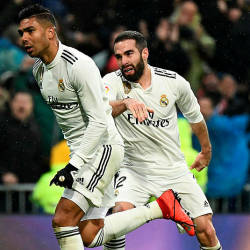 Casameiro celebrates after scoring Real Madrid's first goal against Sevilla as teammate Dani Carvajal joins in. — AFP