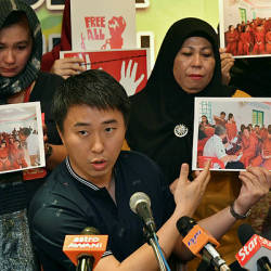 Julau MP Larry Sng, along with family members of the 47 detained Malaysians, show pictures of the latter group during a press conference on Feb 7, 2019. — Bernama