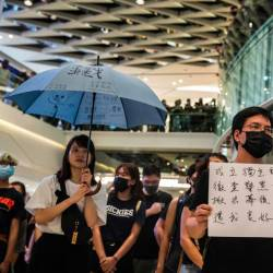 Pro-democracy protesters demonstrate in a shopping mall in the district of Yuen Long to mark the two-month anniversary of the triad attack that took place in the Yuen Long train station, in Hong Kong on Sept 21, 2019. - AFP
