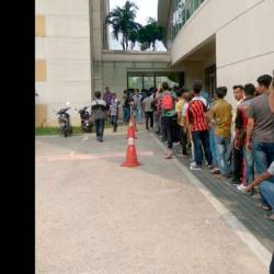 Applicants for the Back for Good amnesty programme queuing at the Immigration Department.