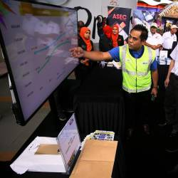 Transport Minister Anthony Loke Siew Fook (R) listens to PLUS deputy traffic safety senior manager Yusoff Ahmad speak on the traffic accident rate statistics at the 'Click For Community Safety' Programme in Seremban today. - Bernama
