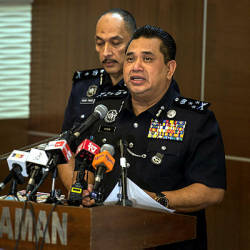 Federal police CID director Comm Datuk Huzir Mohamed speaking at a press conference in Bukit Aman today. — Bernama