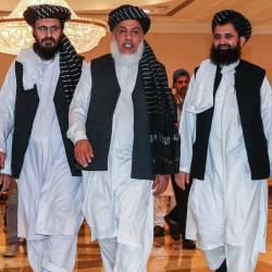 In this file photo taken on July 8, 2019, Mohammad Nabi Omari (C-L), a Taliban member formerly held by the US at Guantanamo Bay and reportedly released in 2014 in a prisoner exchange, Taliban negotiator Abbas Stanikzai (C-R), and former Taliban intelligence deputy Mawlawi Abdul Haq Wasiq (R) walk with another Taliban member during the second day of the Intra Afghan Dialogue talks in the Qatari capital Doha. - AFP