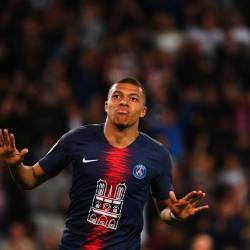 In this file photo taken on April 21, 2019 Paris Saint-Germain's French forward Kylian Mbappe celebrates after scoring his team second goal during the French L1 football match between PSG and Monaco (ASM) at the Parc des Princes stadium in Paris. - AFP