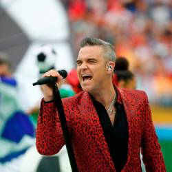 FILE PHOTO: Soccer Football - World Cup - Opening Ceremony - Luzhniki Stadium, Moscow, Russia - June 14, 2018 Robbie Williams performs during the opening ceremony REUTERS/Kai Pfaffenbach/File Photo