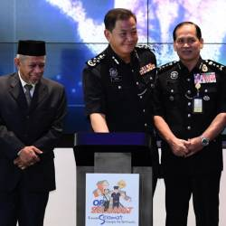 Inspector-General of Police Datuk Seri Abdul Hamid Bador (2nd from L) participates in the launch of Op Selamat 15/2019 in conjunction with the Aidilfitri celebration. - Bernama