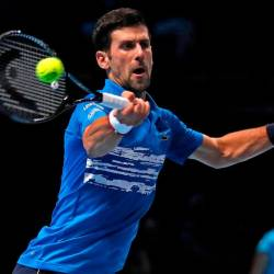 Serbia's Novak Djokovic returns against Italy's Matteo Berrettini during their men's singles round-robin match on day one of the ATP World Tour Finals tennis tournament at the O2 Arena in London on November 10, 2019. - AFP