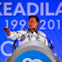 PKR president Datuk Seri Anwar Ibrahim gives his speech during the final day of the national congress at the Malacca International Trade Centre (MITC), today. - Bernama