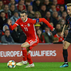 Wales' striker Gareth Bale (L) vies with Croatia's midfielder Ivan Rakitic during the Euro 2020 football qualification match between Wales and Croatia at Cardiff City Stadium, Cardiff on October 13, 2019. — AFP