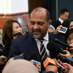 Communications and Multimedia Minister Gobind Singh Deo speaks to reporters at the Parliament lobby today. — Bernama