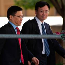China's Vice Finance Minister Liao Min (L) leaves after deputy-level US-China trade talks in Washington, DC, on September 19, 2019. - AFP