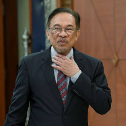 Attend parallel congress and be sacked, warns Anwar