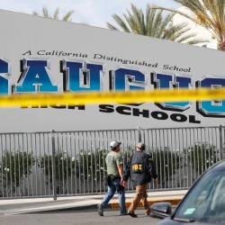 FBI personnel walk at Saugus High School after a shooting at the school left two students dead and three wounded on Nov 14, in Santa Clarita, California. — AFP