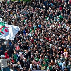Algerian protesters take part in an anti-government demonstration in the capital Algiers on Dec 12, during the presidential election. — AFP
