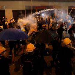 Police tear gas at protesters to disperse them after a march against a controversial extradition bill in Hong Kong on July 21, 2019. — AFP