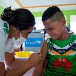 This handout picture taken on Dec 2, and released from Unicef Samoa on Dec 4 shows a boy receiving a vaccine during a nationwide campaign against measles in the Samoan town of Le'auva'a. — AFP