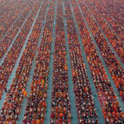 A handout photo taken on December 8, 2019 and released by Dhammakaya Fondation shows monks lining up for alms during the alms-giving ceremony to 30,000 monks organize by the region government of Mandalay affiliated with Dhammakaya Foundation at Chanmyathazi Airport in Mandalay. - AFP