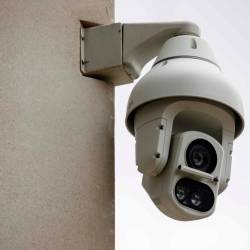 In this file photo taken on Aug 16, 2019 an Avigilon CCTV camera is seen on a wall in King's Cross, London. — AFP