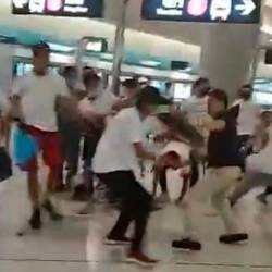 This frame grab taken from video recorded on July 21, 2019 and released by Hong Kong lawmaker Lam Cheuk Ting shows a mob of men in white T-shirts clashing with pro-democracy protesters on the platform of Yuen Long station in Hong Kong. — AFP
