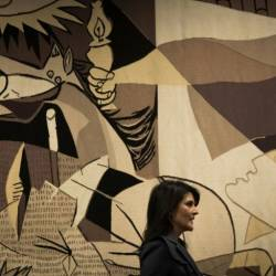 "Then-US ambassador to the United Nations Nikki Haley walks past a replica of ""Guernica"" by Pablo Picasso at the UN headquarters in January 2018. — AFP"