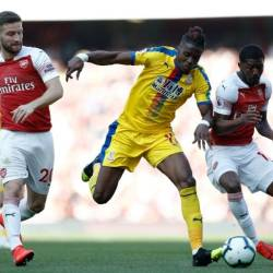 Crystal Palace's Wilfried Zaha punished sloppy Arsenal. — AFP