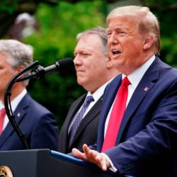 US National Security Advisor Robert O'Brien, and Secretary of State Mike Pompeo look on as US President Donald Trump speaks during a press conference on China in the Rose Garden of the White House in Washington, DC on May 29, 2020. — AFP
