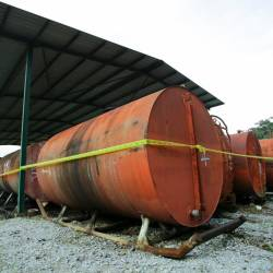 Some of the oil storage tanks illegally stored in Kampung Bemban Hilir today. - Bernama