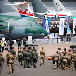Soldiers walk past aircrafts on static display, at the eve of the opening of the 53rd International Paris Air Show at Le Bourget Airport near Paris, France. — Reuters