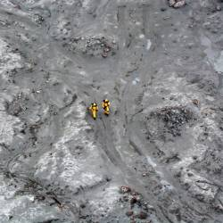 This handout aerial photo taken and released on Dec 13, by the New Zealand Defence Force shows elite soldiers taking part in a mission to retrieve bodies from White Island after the Dec 9 volcanic eruption, off the coast from Whakatane on the North Island. — AFP