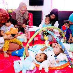Filepic of mothers and minders tending to children at a nursery located in the Muadzam Shah federal government administration complex in Alor Star, Kedah.