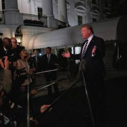 US President Donald Trump speaks to the press as he departs the White House in Washington, DC, on August 23, 2019, for the G7 Summit in France. - AFP