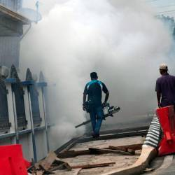 Kota Setar district health services staff perform fogging operations at a row of shops near the City Plaza shopping center on June 25, 2019 to handle the Chikungunya outbreak. - Bernama