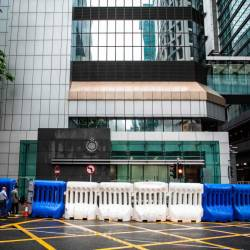 Water barriers stand outside the Hong Kong Police Headquarters in the city's Wan Chai district on July 20, 2019, ahead of an expected anti-government rally on July 21. - AFP