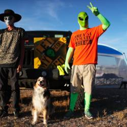 Revelers poseat the 'Storm Area 51' spinoff event 'Alienstock' on Sept 20, 2019 in Rachel, Nevada. - AFP